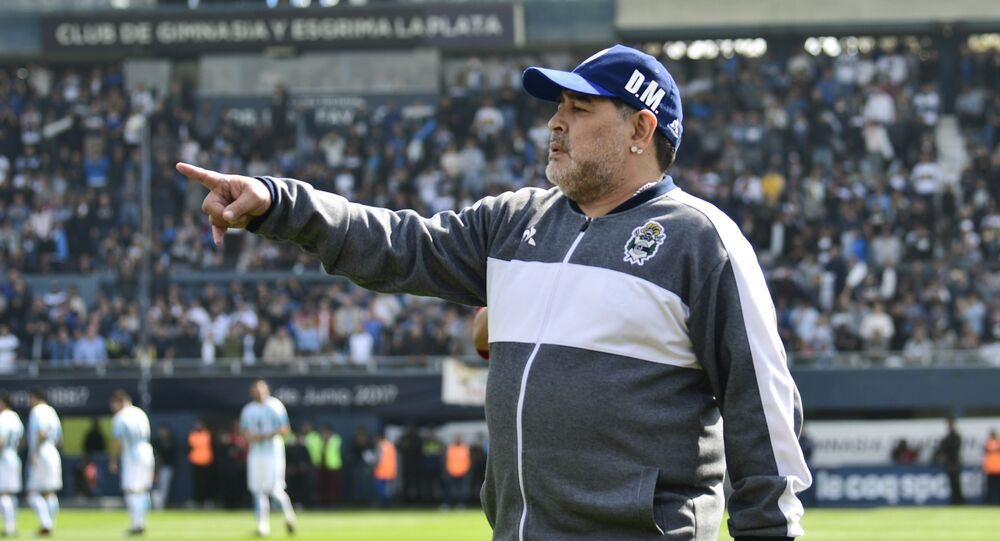Diego Maradona, head coach of Gimnasia y Esgrima La Plata soccer team, points prior to his team's local tournament match against Racing Club at Juan Carmelo Zerillo stadium in La Plata, Argentina, Sunday, Sept. 15, 2019