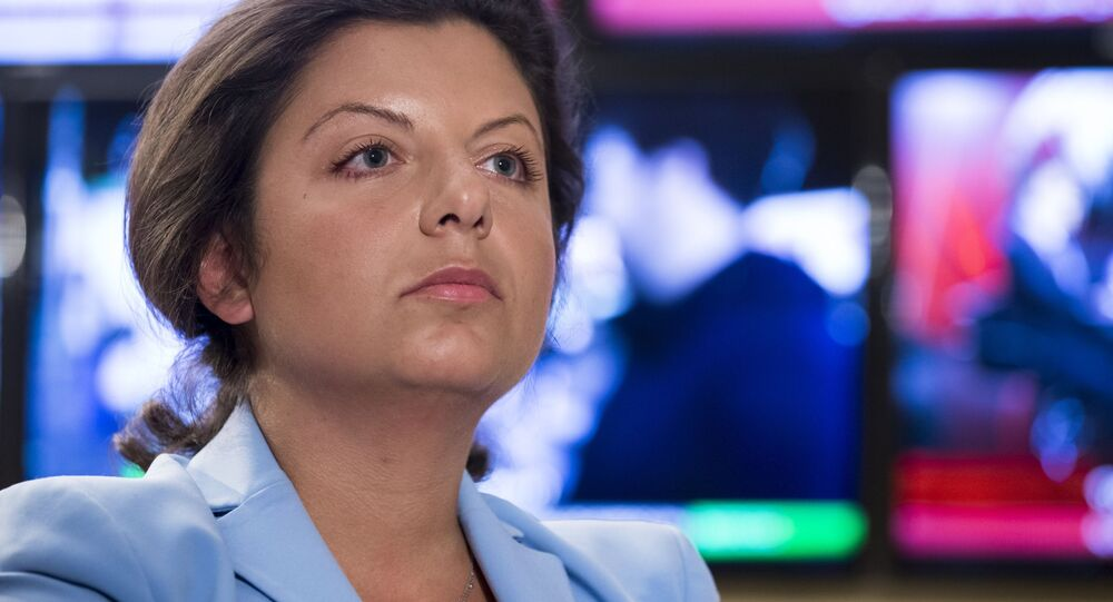 In this photo taken on Friday, Jan. 19, 2018, Margarita Simonyan, the head of the Russian television channel RT, listens to a question during her interview with the Associated Press in Moscow, Russia. Simonyan, the head of Russian television channel RT
