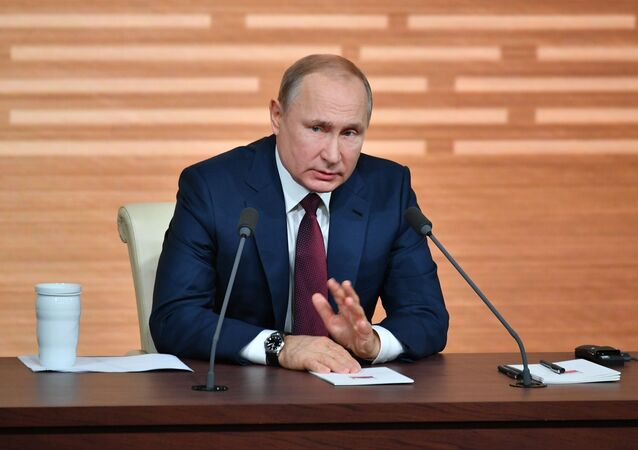 Russian President Vladimir Putin talks to the media during his annual news conference, in Moscow, Russia