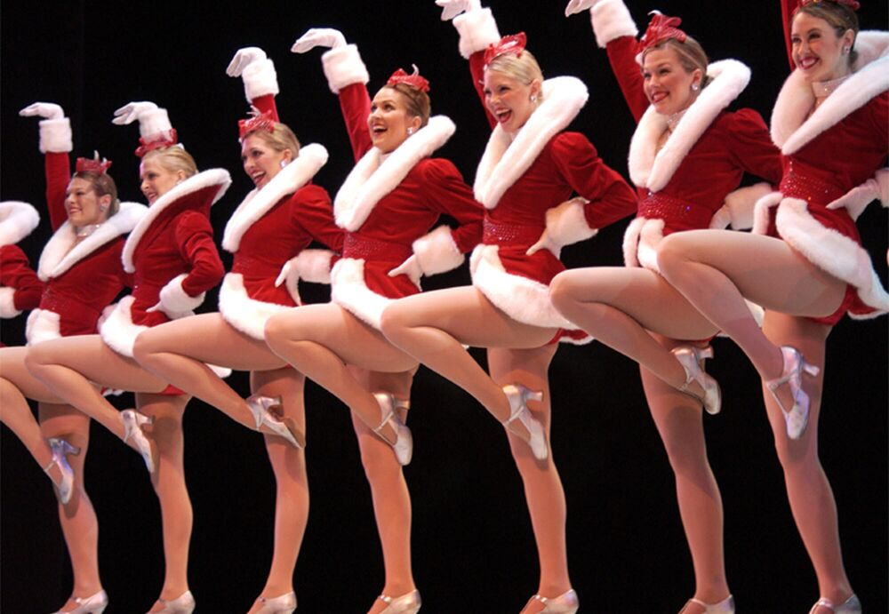 Members of the Radio City Rockettes wear their Christmas costumes Wednesday, 14 April  2004, at The Wang Theatre in Boston, during a performance held to promote their Christmas Spectacular show at the Wang from  2 -31 Dec. 2004.
