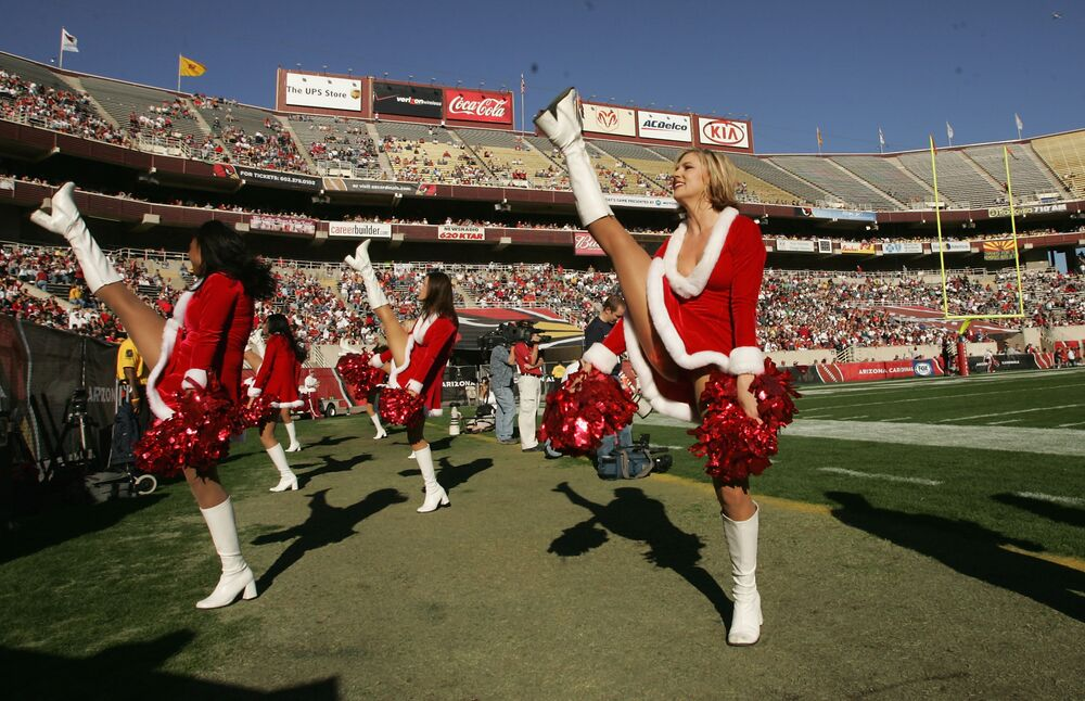 Arizona Cardinals cheerleaders wearing Santa costumes perform in the game with the Philadelphia Eagles on 24 December 2005 at Sun Devil Stadium in Tempe, Arizona. The Cardinals won 27-21.