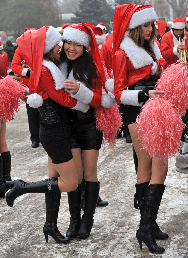 Kyrgyz and Russian girls wearing Santa Claus costumes take part a New Year parade in the Kyrgyz capital Bishkek, on 31 December 2010. New Year, which was the biggest informal holiday of the year in the former Soviet Union, is also very popular in the predominantly Muslim Central Asian nation of Kyrgyzstan.