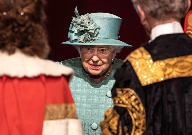 Britain's Queen Elizabeth talks with officials following her speech during at the State Opening of Parliament at the Palace of Westminster in London, Britain December 19, 2019