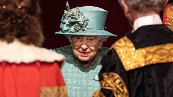 Britain's Queen Elizabeth talks with officials following her speech during at the State Opening of Parliament at the Palace of Westminster in London, Britain December 19, 2019 - Sputnik International