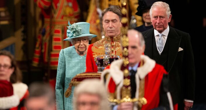 Britain's Queen Elizabeth and Britain's Prince Charles walk through the Royal Gallery before delivering the Queen's Speech at the State Opening of Parliament ceremony at the Palace of Westminster in London, Britain December 19, 2019
