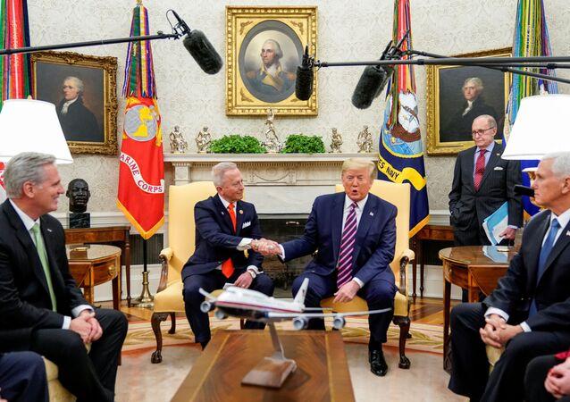 U.S. President Donald Trump shakes hands with U.S. Representative Jeff Van Drew