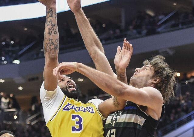 Los Angeles Lakers forward Anthony Davis (3) shoots over Milwaukee Bucks center Robin Lopez (42) in the fourth quarter at Fiserv Forum in Milwaukee, Wisconsin. Mandatory Credit: Benny Sieu-USA TODAY Sports