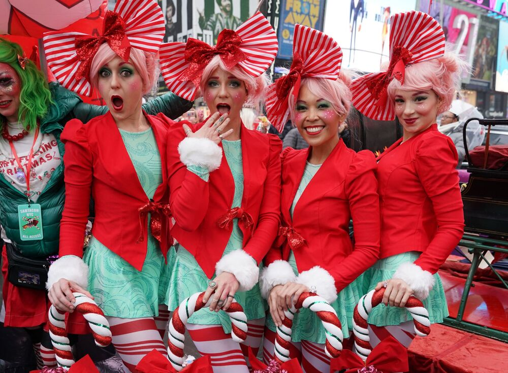 Revellers gather for the start of the Annual SantaCon Bar Crawl at Father Duffy Square, a section of Times Square, on 14 December 2019, in New York. SantCon is an event where people make donations to charitable causes and dress up in holiday costumes and visit bars around the city.