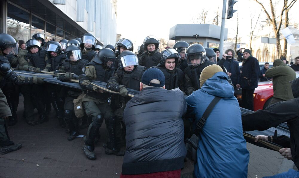 Ukrainian activists clash with riot police during a protest of agricultural workers against land reform in Kiev, Ukraine that would end a moratorium on the sale of land; protesters are concerned that land will be bought up by wealthy companies and individuals.