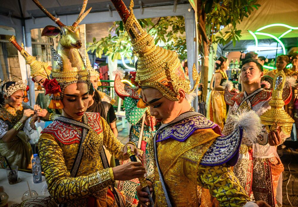 Traditional Thai dancers prepare to perform during a street festival in Bangkok on 15 December 2019.