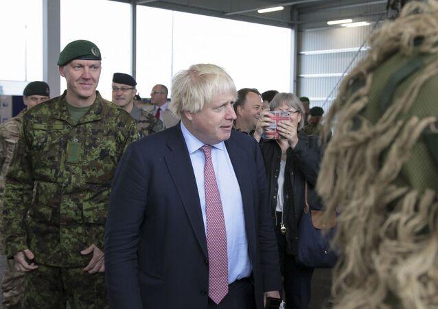 In this Estonian Army photo made available on Friday, Sept. 8 2017, British Foreign Secretary Boris Johnson visits a NATO military unit outside Tallinn, Estonia