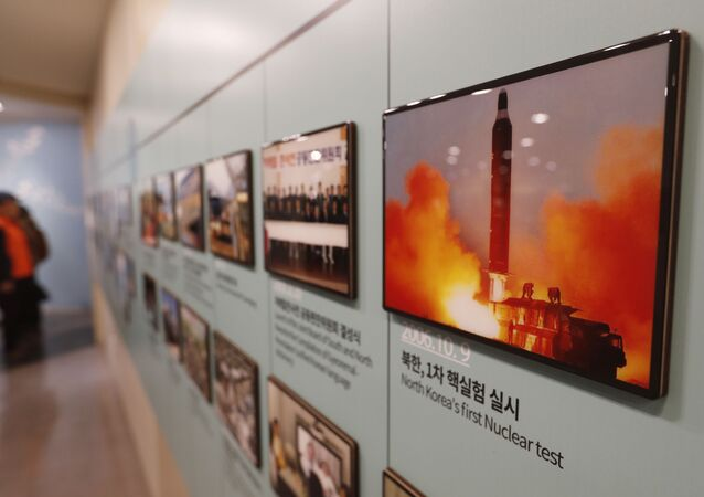 In this Friday, Dec. 13, 2019, photo, an image showing North Korea's missile launch is displayed at the Unification Observation Post in Paju, South Korea, near the border with North Korea