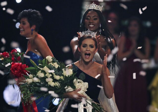 Camille Schrier, of Virginia, right, reacts after winning the Miss America competition at the Mohegan Sun casino in Uncasville, Connecticut, Thursday, 19 December 2019
