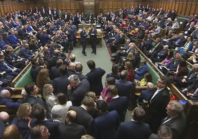 Lawmakers await the result of the vote on The European Union (Withdrawal Agreement) Bill in the House of Commons in London, Friday Dec. 20, 2019. British lawmakers approved in principle Prime Minister Boris Johnson's Brexit bill, clearing the way for the U.K. to leave the European Union next month. The House of Commons voted 358-234 on Friday for the Withdrawal Agreement Bill.