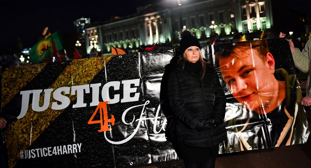Harry Dunn's mother Charlotte Charles poses in front of a banner outside the Buckingham Palace as people demonstrate during U.S. President Donald Trump's visit for NATO summit, in London, Britain December 3, 2019.