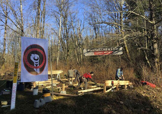 Anti-pipeline activists build a so-called Watch House near Kinder Morgan's tank farm in Burnaby, British Columbia