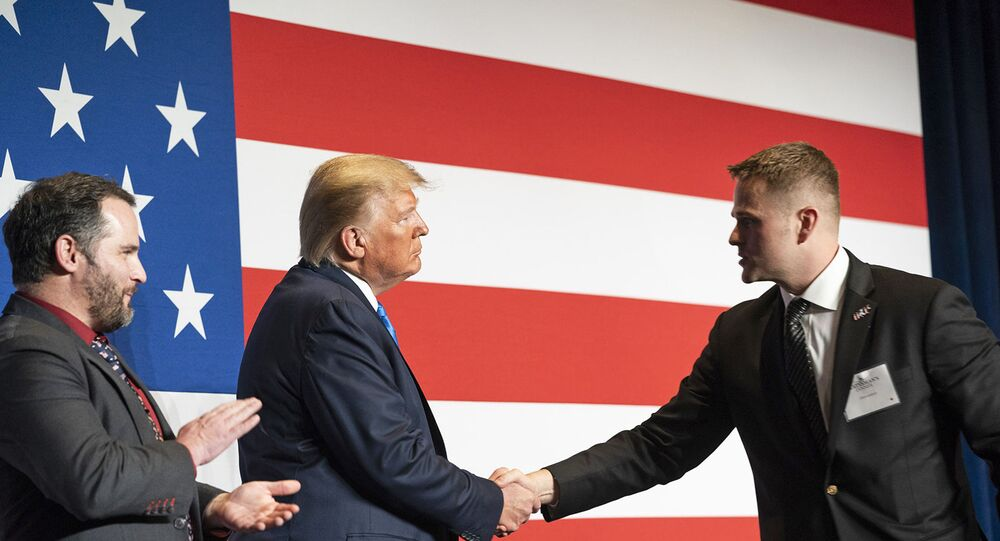 President Donald J. Trump welcomes Army First Lieutenant Clint Lorance and Army Major Mathew Golsteyn to the stage prior to his remarks at the Republican Party of Florida's Statesman Dinner Saturday, Dec. 7, 2019, in Aventura, Fla.