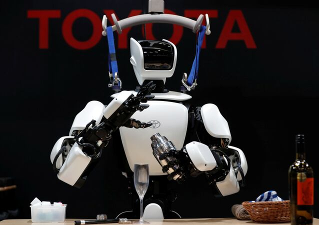 Toyota's humanoid robot T-HR3 makes a cocktail as it is remotely controlled by an operator at its demonstration at the International Robot Exhibition 2019 in Tokyo, Japan December 18, 2019.