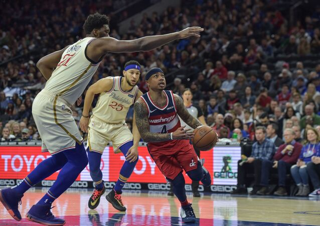 Washington Wizards guard Isaiah Thomas (4) drives to the basket as Philadelphia 76ers center Joel Embiid (21) defends during the first quarter of the game