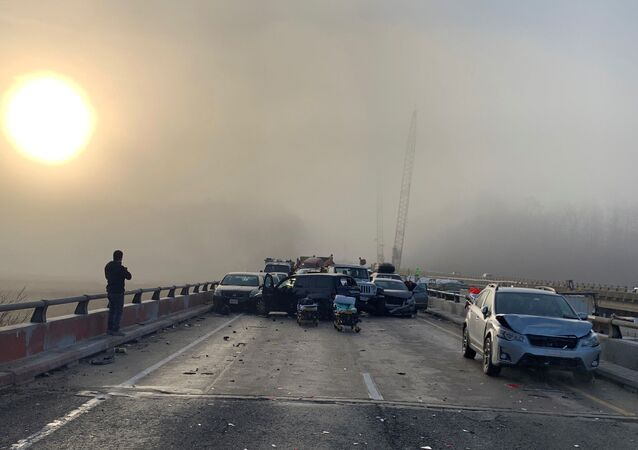 Damaged vehicles are seen after a chain reaction crash on I-64 in York County, Virginia, U.S. December 22, 2019
