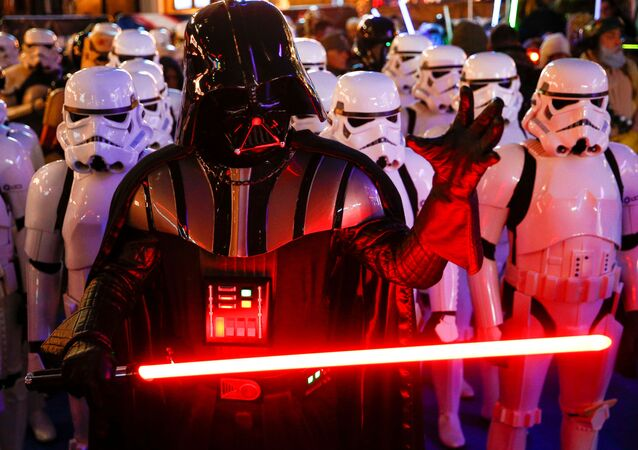 A person dressed as Darth Vader and others as Storm Troopers attend the premiere of Star Wars: The Rise of Skywalker in London, Britain, December 18, 2019.