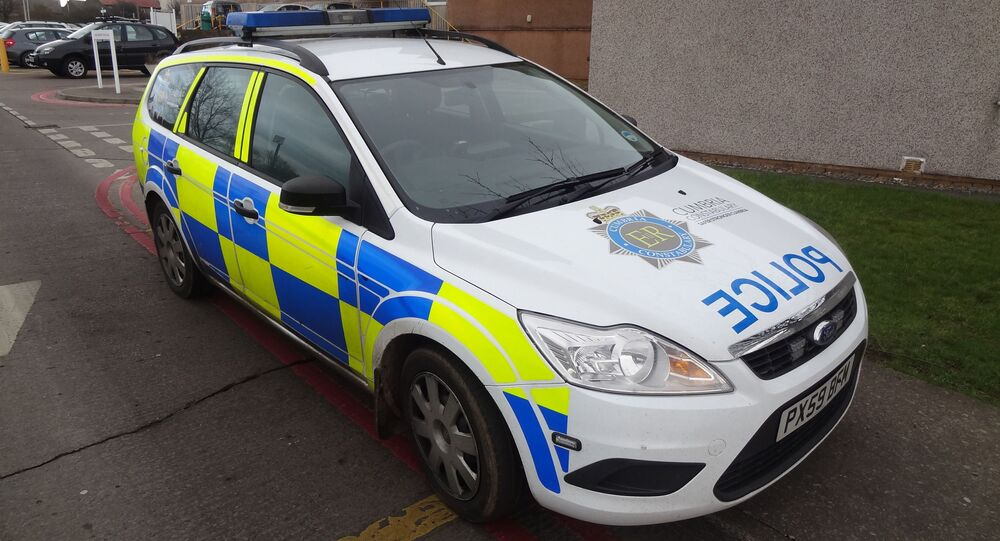Cumbria police car, with POLICE in mirror writing (ECILOP).