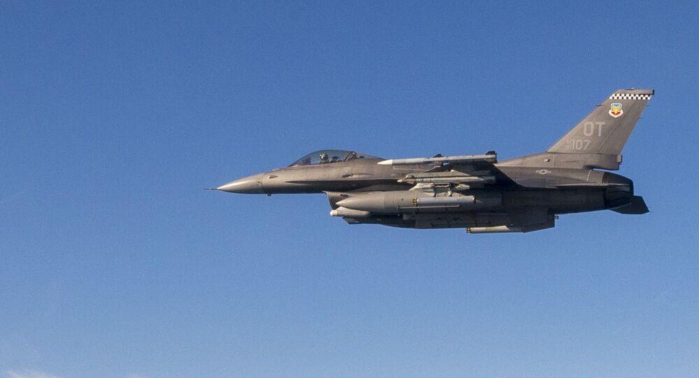 A F-16C flown by Maj Jeffrey Entine,  85th Flight Test Squadron test pilot, prepares to fire a rocket at a test drone at Eglin Air Force Base, Fla., Dec. 19, 2019