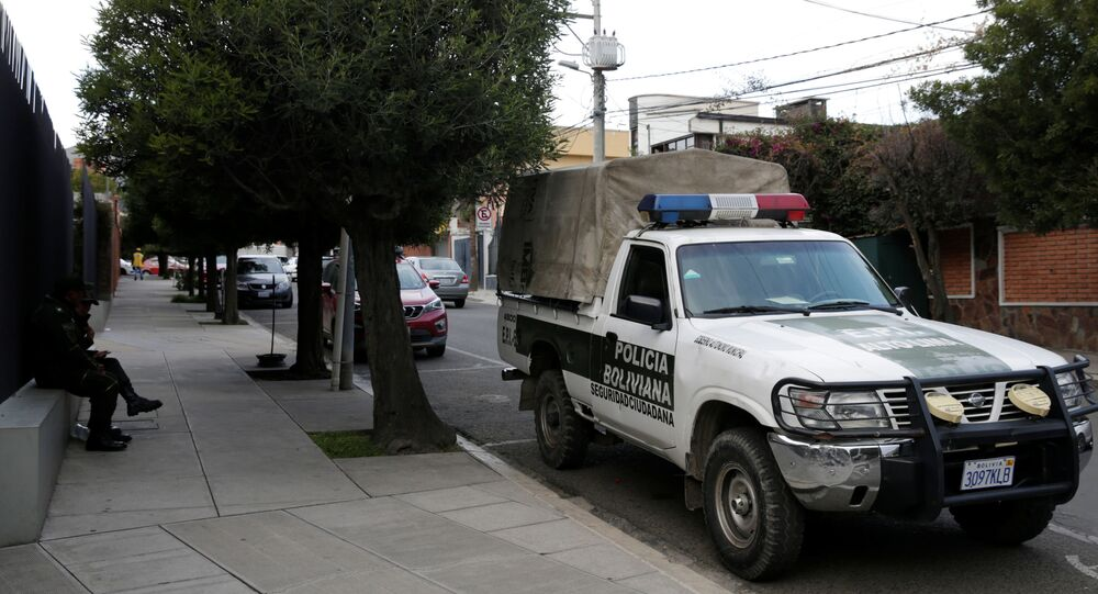 A police patrol vehicle at the entrance of Mexico's embassy in La Paz, Bolivia