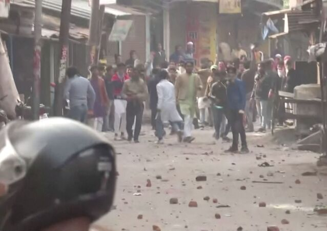 Protesters pelt police personnel with rocks during clashes over the citizenship law in Gorakhpur, Uttar Pradesh, India on 20 December 2019 in this still image taken from a video