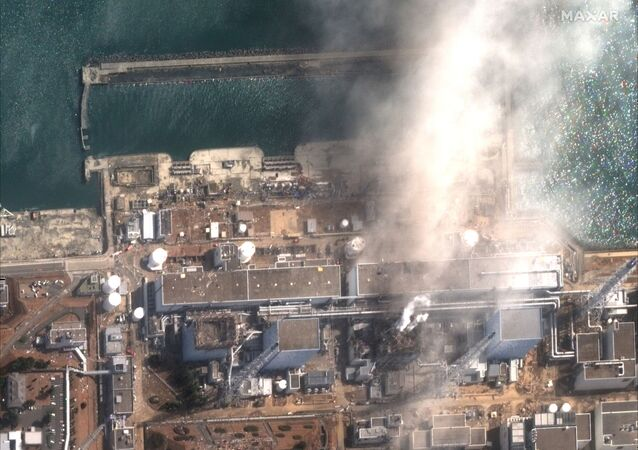The Fukushima Daiichi Nuclear Power Plant is seen after an explosion, in this handout satellite image taken 14 March 2011 and released on 24 December 2019 by Maxar Technologies