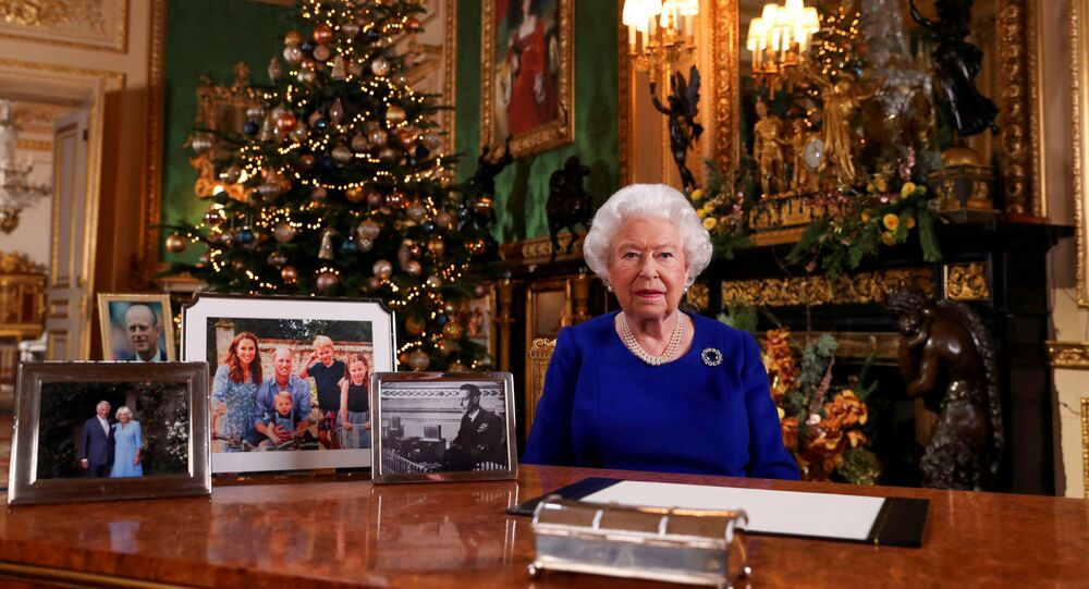 Britain's Queen Elizabeth poses, after recording her annual Christmas Day message in Windsor Castle, in Berkshire, Britain, in this undated picture released on December 24, 2019.