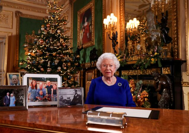 Britain's Queen Elizabeth poses, after recording her annual Christmas Day message in Windsor Castle, in Berkshire, Britain, in this undated picture released on 24 December 2019.