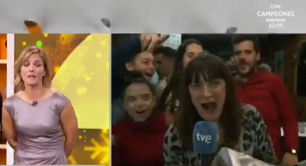 Spanish TV reporter apologises over the emotional live lottery win