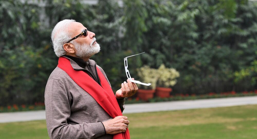 PM Modi watching the Solar Eclipse