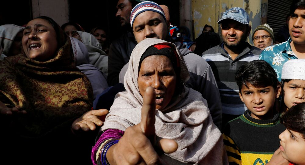 Saira, mother of Aleem Ansari, who died during clashes with police following protests against a new citizenship law, mourn outside their house in Meerut, in the northern state of Uttar Pradesh, India, December 24, 2019