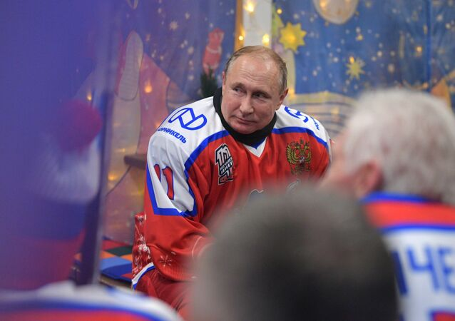 Russian President Vladimir Putin during a break at the New Year friendly match of the Night Hockey League at the rink on Red Square