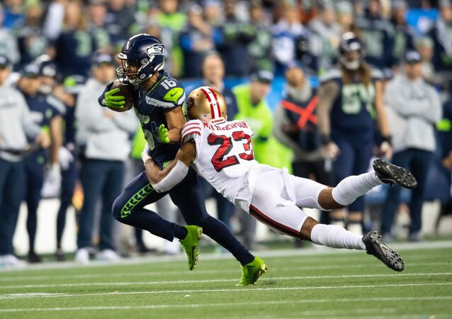Dec 29, 2019; Seattle, Washington, USA; San Francisco 49ers cornerback Ahkello Witherspoon (23) dives to tackle Seattle Seahawks wide receiver Tyler Lockett (16) during the first half at CenturyLink Field