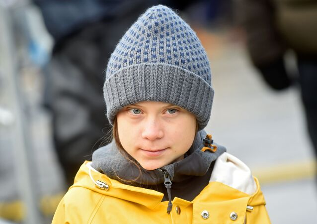 Climate change activist Greta Thunberg attends a news conference during a Fridays for Future protest in Turin, Italy, 13 December 2019