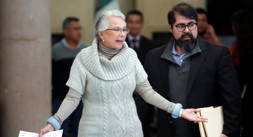 Mexico's Interior Minister Olga Sanchez Cordero arrives at a news conference in Mexico City, Mexico December 30, 2019.