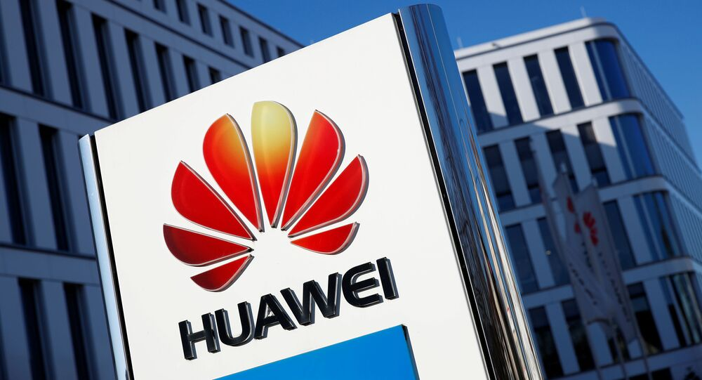 The logo of Huawei Technologies is pictured in front of the German headquarters of the Chinese telecommunications giant in Duesseldorf, Germany, February 18, 2019