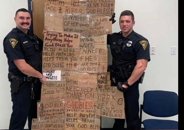 Mobile Alabama Police Department officers seen holding homeless quilt made out of signs confiscated from panhandlers