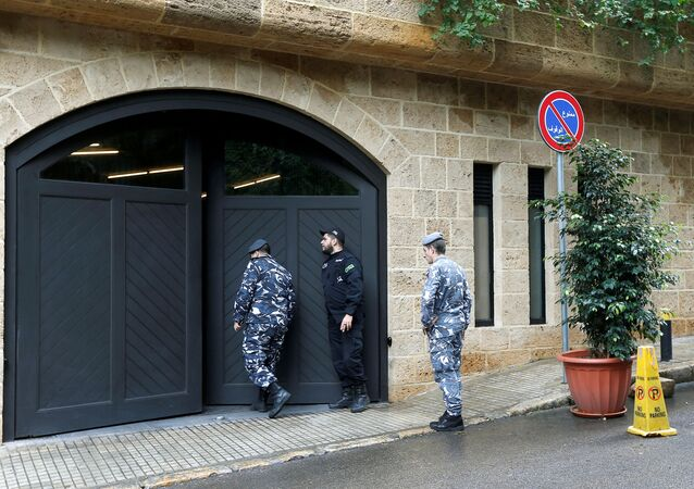 Lebanese police officers are seen at the entrance to the garage of what is believed to be former Nissan boss Carlos Ghosn's house in Beirut