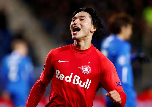FC Salzburg's Takumi Minamino celebrates scoring their second goal