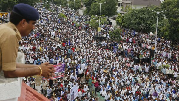 A policeman keeps vigil as hundreds of members of India's low-caste Dalit community gather for a rally to protest against the attack on their community members in Ahmadabad, India, Sunday, July 31, 2016. - Sputnik International