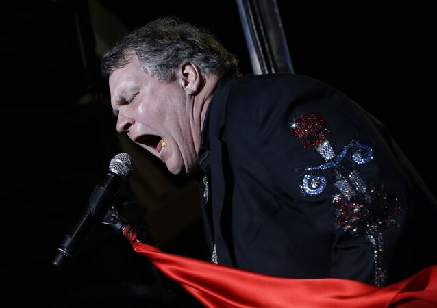 Singer Meat Loaf performs in support of Republican presidential candidate and former Massachusetts Gov. Mitt Romney at the football stadium