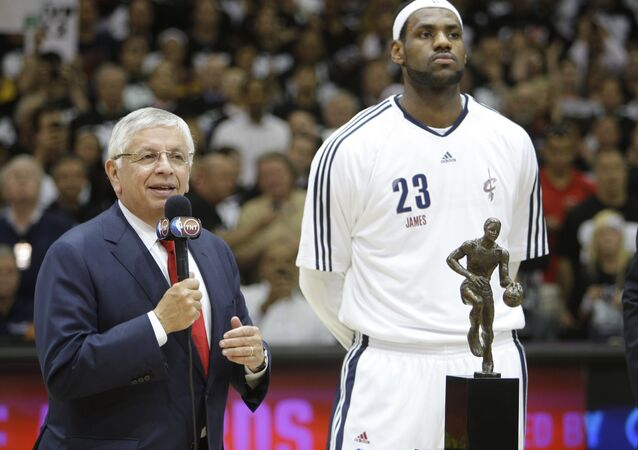 NBA Commissioner David Stern, left, presents the NBA MVP trophy to Cleveland Cavaliers' LeBron James
