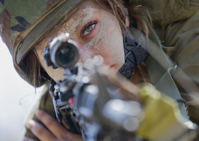 An Israeli female soldier from the mixed-gender Bardalas battalion takes part in a training at a military camp near the northern Israeli city of Yoqne'am Illit on September 13, 2016. - The Bardales battalion began operating in July 2015.