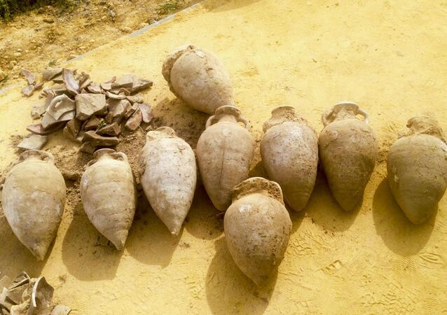 19 amphoras containing thousands of unused bronze and silver-coated coins dating from the end of the 4th century.