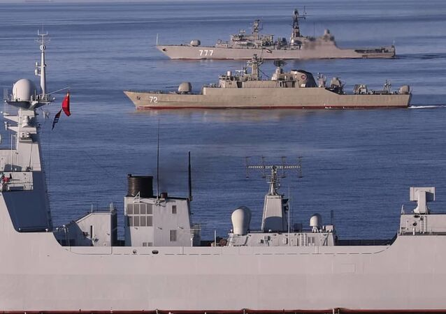 A photo shows a view of the Chinese People's Liberation Army Navy Surface Force Type 052D destroyer Xining (117), the Islamic Republic of Iran Navy frigate ALBORZ (72), and the Russian Navy Neustrashimyy-class frigate Yaroslav Mudry (777) during joint Iran-Russia-China naval drills in the Indian Ocean and the Gulf of Oman