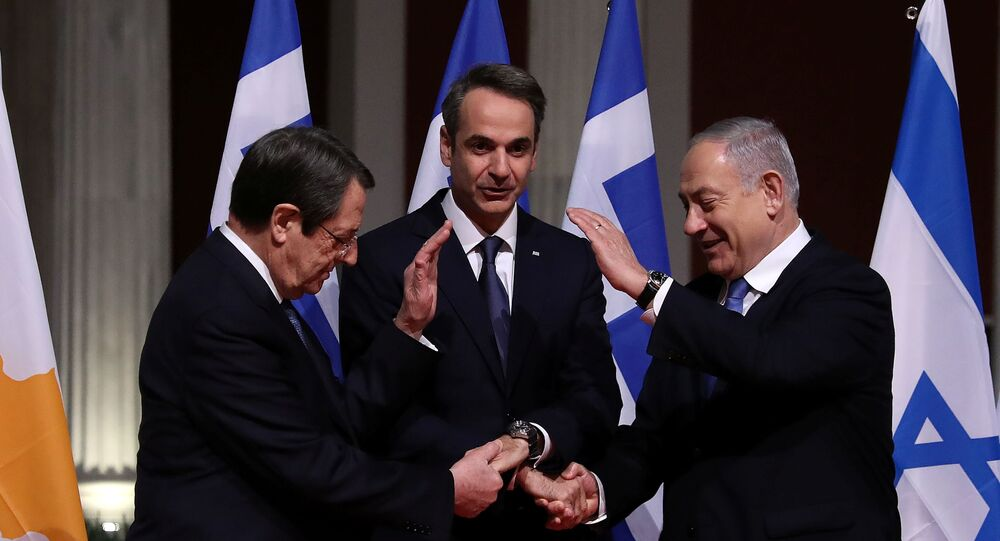 Cypriot President Nicos Anastasiades, Greek Prime Minister Kyriakos Mitsotakis and Israeli Prime Minister Benjamin Netanyahu pose for a photo before signing a deal to build the EastMed subsea pipeline to carry natural gas from the eastern Mediterranean to Europe, at the Zappeion Hall in Athens, Greece, January 2, 2020.